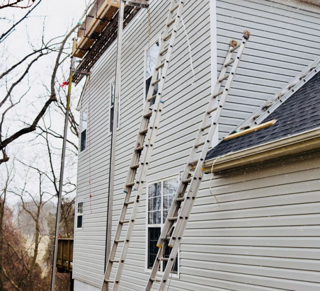 Ladders against home as siding renovation continues