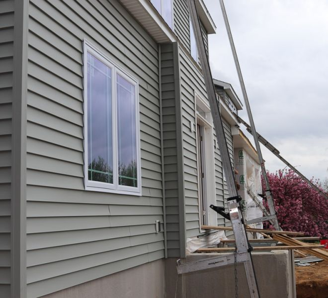 New Gray siding installation