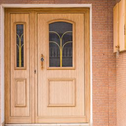 Upgraded wooden front door home improvement