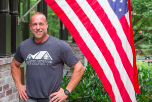 Veteran and owner of Trusted Vets owner Mike McIntosh with American Flag