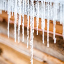 Gutters dripping with ice crystals